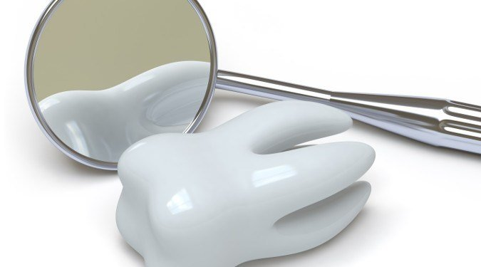 Tooth Next to a Dental Mirror